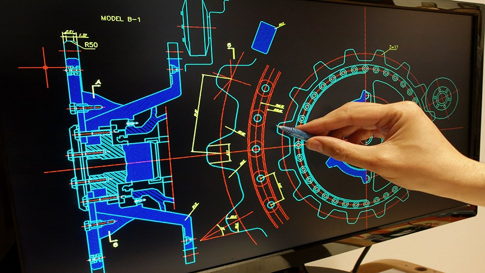 Technician Measuring Specifications of Component on Design Plans on Computer
