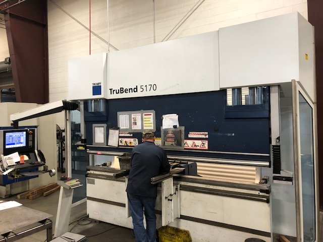 Technician Working at TruBend Trumpf Press Brake Unit