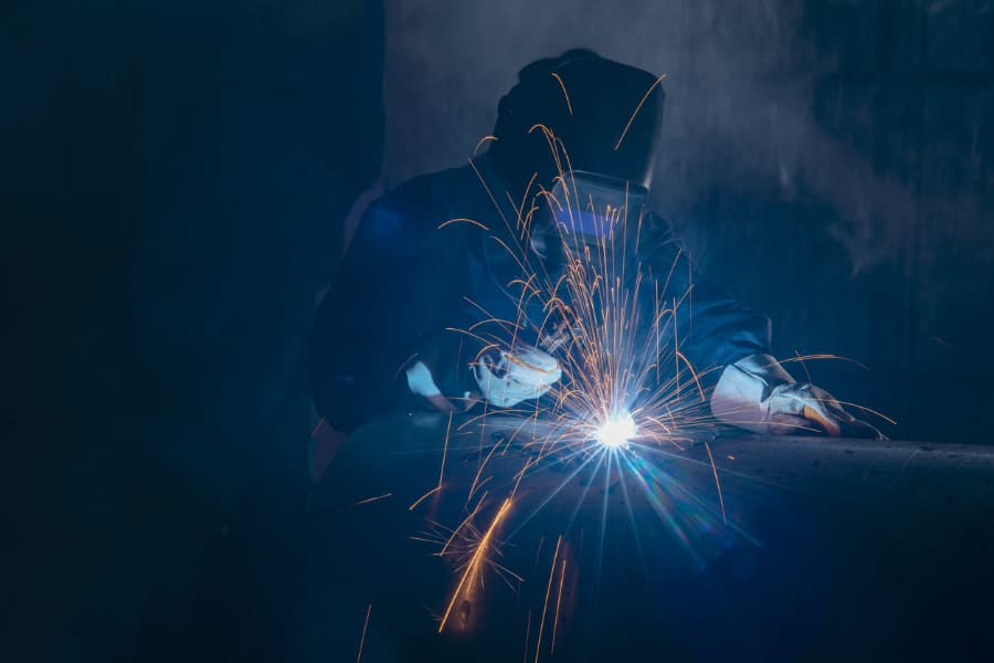 Professional Welder Working in Dim Environment